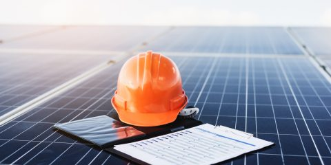 Orange helmet and documents On solar cells